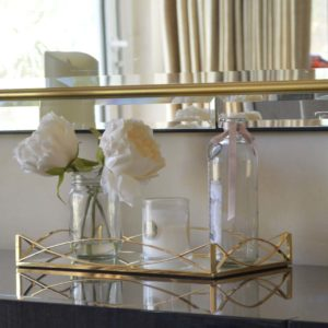 Gold Wavy Rectangular Decorative Tray In A Living Room