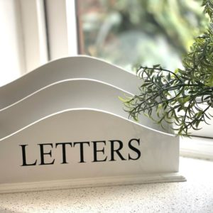 Lifestyle Picture Of A 2 Rack Letter Mail Holder